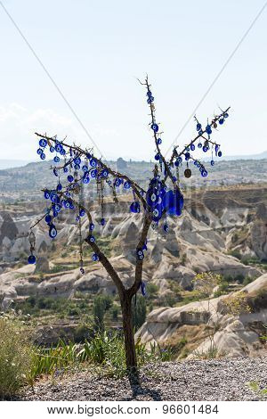 GOREME, TURKEY - JUNE 16, 2014: Evil eye in tree behind Love valley in Goreme national park. Cappadocia Turkey