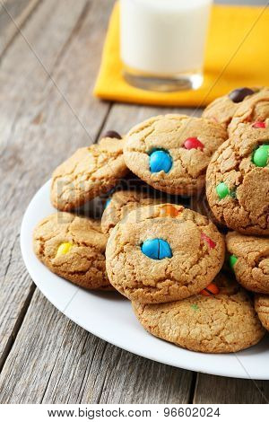 Cookies With Colorful Candy In Plate On White Wooden Background