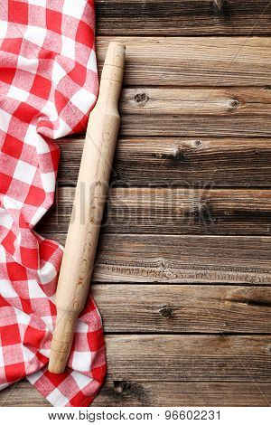 Napkin With Plunger On Brown Wooden Background