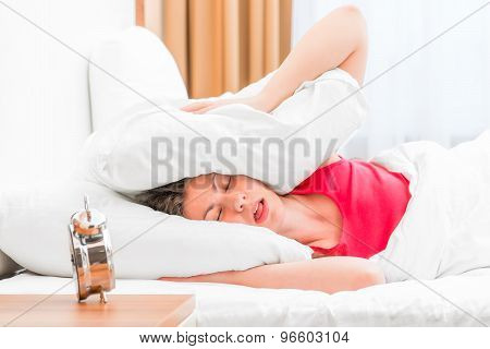 Woman Covering Her Ears Pillows And Fell Asleep