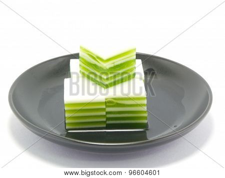 green jelly layer on black dish