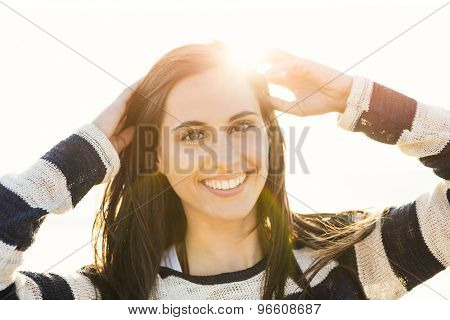Portrait of a beautiful latin young woman at the beach