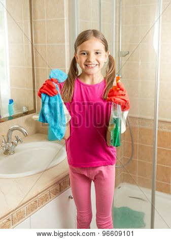 Girl In Rubber Gloves Cleaning Bathroom With Cloth And Spray