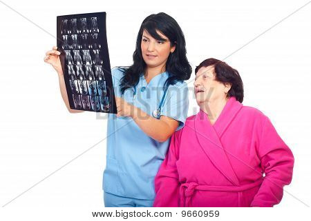 Doctor Woman Review Mri With Her Elderly Patient