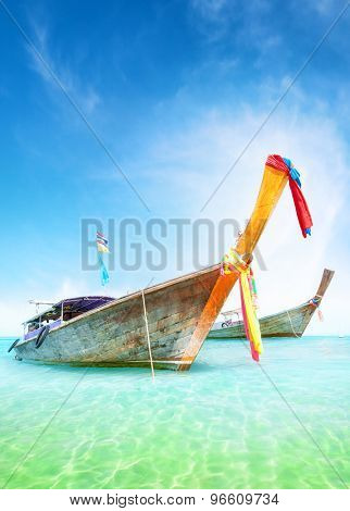 Vacation journey summer background. Traditional thai boats on turquoise water of tropical sea shore