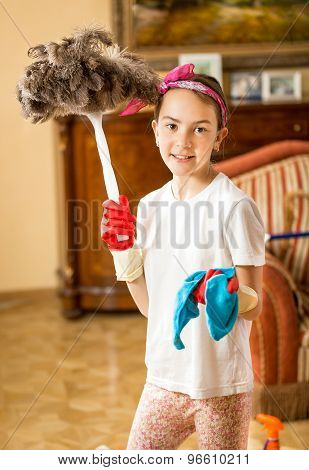 Smiling Girl Helping With Housework And Cleaning
