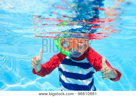 cute little boy swimming underwater