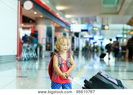 little girl with suitcase travel in the airport