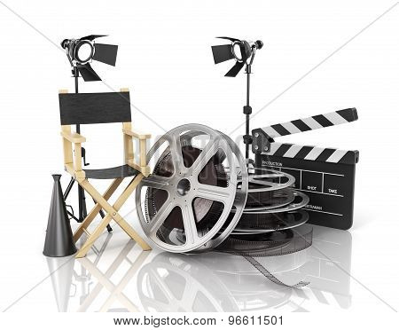 Video, Movie, Cinema Concept. Light, Film Strip, Reels, Clapperboard And Director Chair On The White