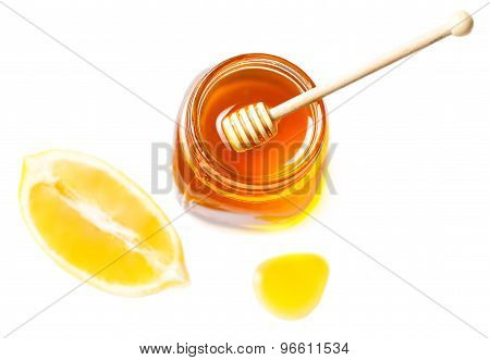 Honey And Lemon Isolated On A White Background. Sweet Honey Dripping In A Glass Jar.