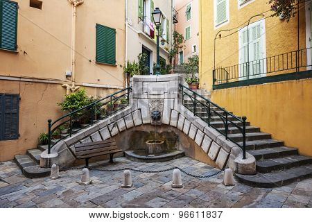 Small square with fountain Place du Conseil used to be the center of local government in medieval town Villefranche-sur-Mer on French Riviera, France.