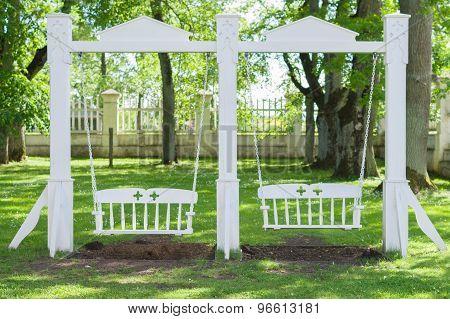 Vintage White Wooden Swing In The Garden