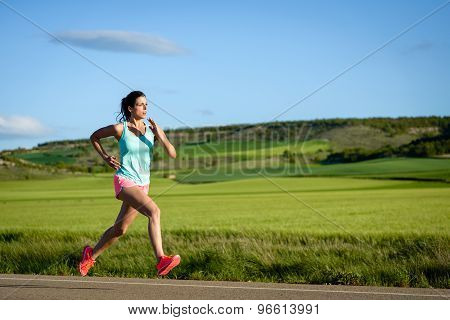 Woman Running Fast On Countryside Road