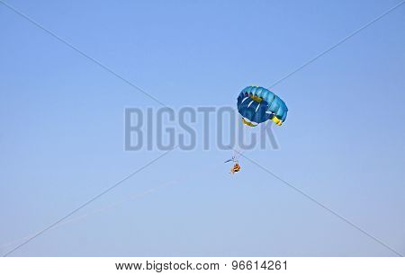 People Enjoy Paragliding In The Sky