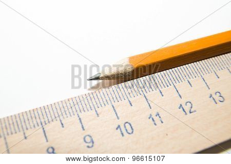 Notepads, Pencil And Wooden Ruler On A White Background