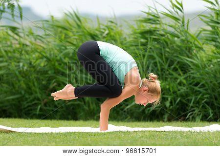 Woman Making Yoga Crow Pose