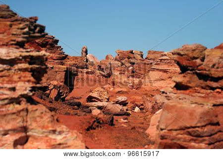 Red rocky outcrop and blue ocean at Broome