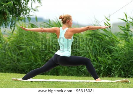 Yoga Virabhadrasana Ii Warrior Pose By Woman