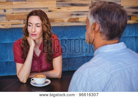 bored couple having coffee together in cafe