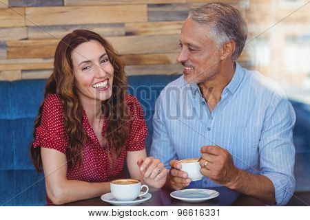 Cute couple drinking coffee in the cafe