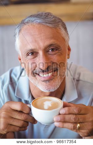 Man sitting in cafe having coffee in a cafe