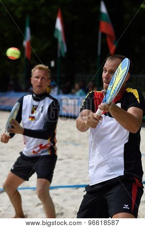 MOSCOW, RUSSIA - JULY 19, 2015: Benjamin Ringlstetter (right) and Nils Muschiol of Germany in action during the ITF Beach Tennis World Team Championship. 28 nations compete in the event this year