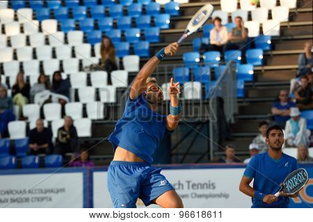 MOSCOW, RUSSIA - JULY 19, 2015: Alessandro Calbucci (center) and Marco Garavini of Italy in the final match of the Beach Tennis World Team Championship against Russia. Italy become world champion