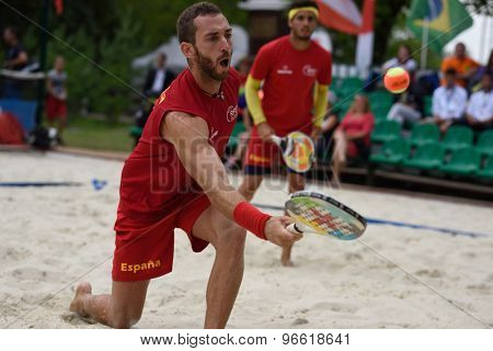 MOSCOW, RUSSIA - JULY 19, 2015: Gerard Rodriguez (in front) and Antomi Ramos-Viera of Spain in the match for 3rd place of the Beach Tennis World Team Championship against Brazil. Spain won the match