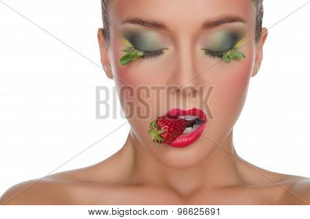 Beautiful Woman With Strawberry In Mouth