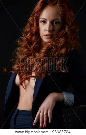 Studio photo of beautiful red-haired model posing