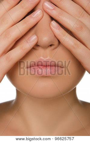 Woman Covers Eyes With His Fingers
