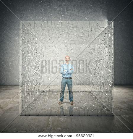 standing man inside broken glass cube