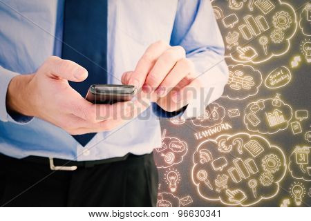 Close up of a businessman using a smartphone against grey background