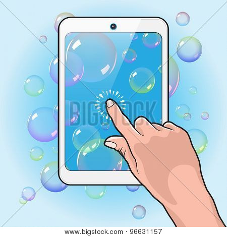 Hand Plays Soap Bubbles on the White Touch Tablet PC