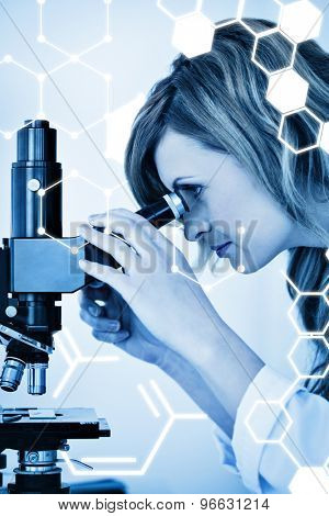 Science graphic against cute blondhaired scientist looking through a microscope