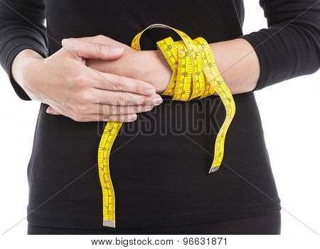 The Woman In Black With Yellow Measuring Tape On Her Hand, Healthcare And Weight Loss Concept.