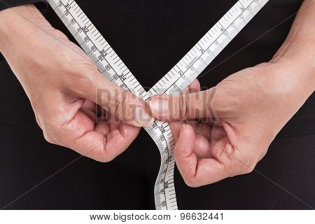 Obese Woman Is Measuring Her Waist By Measuring Tape, Healthcare And Diet Concept.