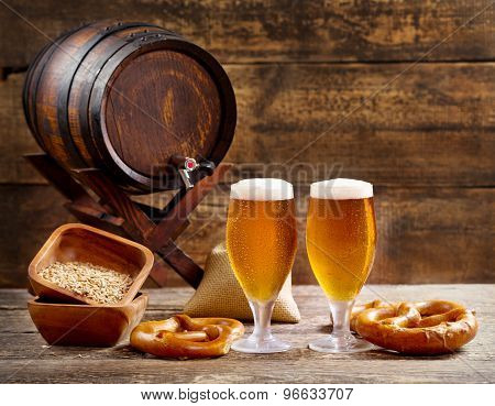 Glasses Of Beer With Barrel