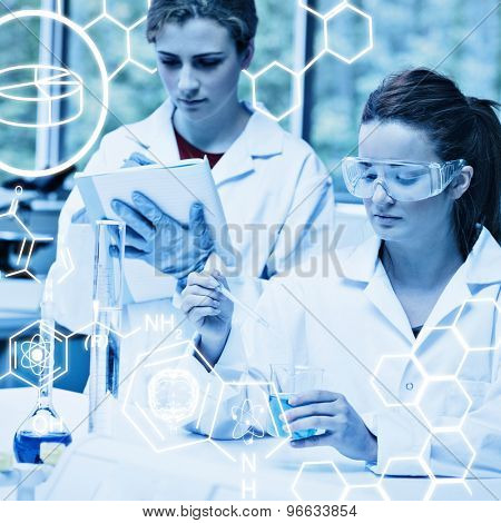 Science graphic against science students doing an experiment