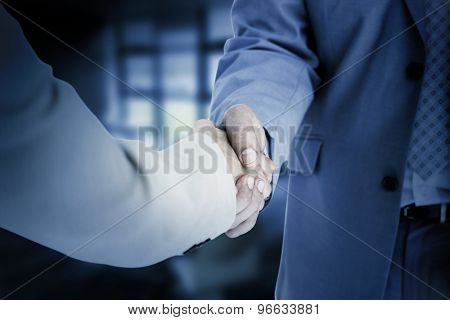 People in suit shaking hands against college
