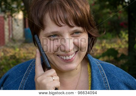 Woman Laughing With Mobile