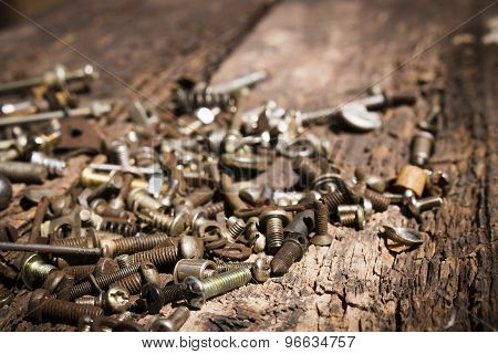 Iron Rusty Tools Bolts And Screws On An Old Wooden Table Close-up Selective Focus