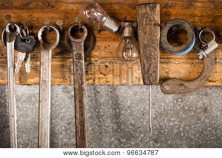 Rusty Wrenches, Adhesive Tape, An Awl, A Light Bulb, A Collar On An Old Wooden Stand