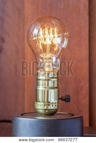 Vintage Edison Light Bulb With Wood Background For Hotel Decoration.