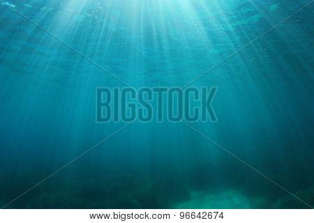 Blue water background underwater in ocean