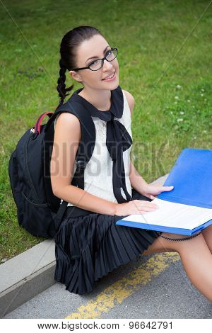 Education Concept - Beautiful School Girl Or Student Reading Something In Park