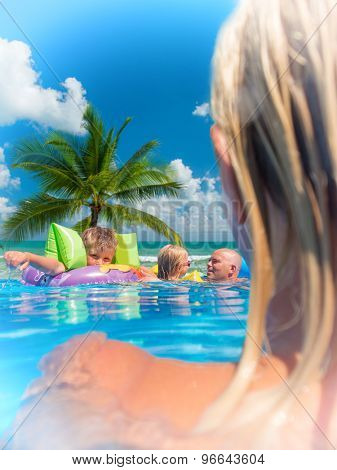 Family Outside Relaxing In Swimming Pool on a lilo