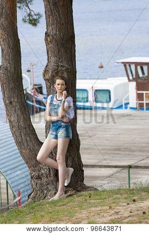 Girl Near Jetty On Lake