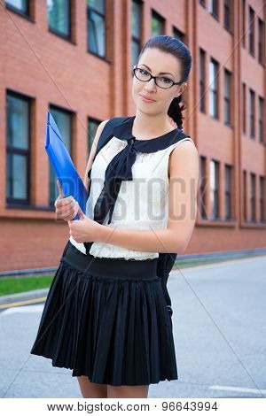 Happy Girl In School Uniform With Backpack In Campus