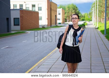 Happy Girl In School Uniform Going To School